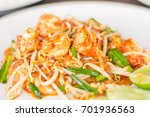 Small photo of Fried noodle mixed with bean sprout, Allium ramosum, roasted peanuts and some meat such as shrimp is called in PADTAI