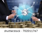 business man on digital stock... | Shutterstock . vector #702011767