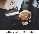 coffee latte art in coffee shop ... | Shutterstock . vector #702013393