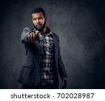 studio portrait of black...   Shutterstock . vector #702028987