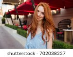 smiling pretty redhead girl... | Shutterstock . vector #702038227