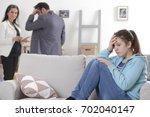family scene. parents divorce... | Shutterstock . vector #702040147