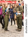 Small photo of EDINBURGH - AUGUST 12, 2017: Unknown performers hand out flyers to the public to publicise their show at the 70th Edinburgh fringe on August 12, 2017.