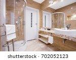 Beige Fancy Bathroom With...