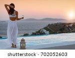 attractive woman in white dress ... | Shutterstock . vector #702052603