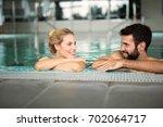 cheerful happy couple relaxing... | Shutterstock . vector #702064717