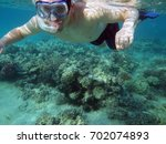 man under water   Shutterstock . vector #702074893