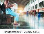 young girl with backpack and... | Shutterstock . vector #702075313