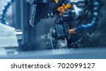 cnc milling machine is working... | Shutterstock . vector #702099127