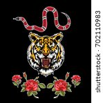 embroidery patch flowers tiger... | Shutterstock .eps vector #702110983