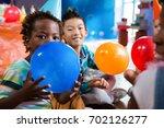 portrait of children playing... | Shutterstock . vector #702126277