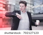 businessman hurrying to meeting ... | Shutterstock . vector #702127123