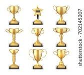 winning golden trophy cups and... | Shutterstock .eps vector #702145207