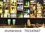 two cocktail glasses with... | Shutterstock . vector #702165667