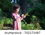 Little Girl In A Rose Dress...