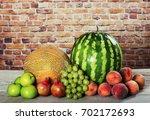 fresh organic fruits mix on... | Shutterstock . vector #702172693