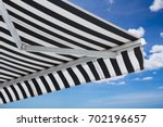 black and white striped awning...   Shutterstock . vector #702196657