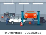 work process in car and tire... | Shutterstock .eps vector #702203533