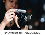 young asian woman looking on... | Shutterstock . vector #702208327