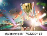 young athlete holding up a gold ... | Shutterstock . vector #702230413