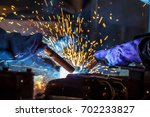 worker with protective mask... | Shutterstock . vector #702233827