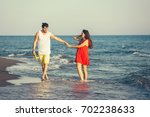 young happy smiling couple... | Shutterstock . vector #702238633