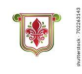 vintage heraldic emblem created ... | Shutterstock . vector #702263143