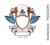 graphic emblem with lion... | Shutterstock . vector #702263293