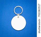 white key ring on blue...   Shutterstock . vector #702282517