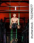 intense workout in dark gym ... | Shutterstock . vector #702290077