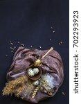 quail eggs on dark background.... | Shutterstock . vector #702293923