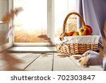 autumn window with wooden table ... | Shutterstock . vector #702303847