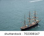tall ship with tourists sailing ... | Shutterstock . vector #702308167