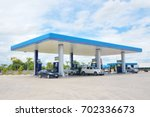 blurred image of gas station | Shutterstock . vector #702336673