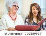 grandmother and granddaughter... | Shutterstock . vector #702359917