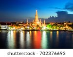 wat arun temple at sunset... | Shutterstock . vector #702376693