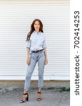 young stylish woman wearing...   Shutterstock . vector #702414253