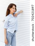 young stylish woman wearing...   Shutterstock . vector #702421897
