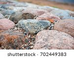 colored stones on the coast ... | Shutterstock . vector #702449383