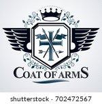 heraldic design  vintage emblem. | Shutterstock . vector #702472567