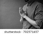 closeup on a young man pray ... | Shutterstock . vector #702571657