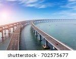china dalian  the sea across...   Shutterstock . vector #702575677