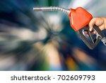 handle holds the dispenser. on... | Shutterstock . vector #702609793