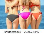 beautiful young women at sea...   Shutterstock . vector #702627547