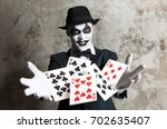 bluff  scary evil clown playing ... | Shutterstock . vector #702635407