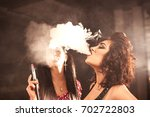 charming women exhales hookah... | Shutterstock . vector #702722803