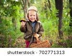 fresh mushrooms in kid hands.... | Shutterstock . vector #702771313