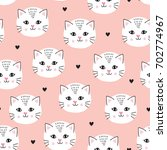 Stock vector seamless pastel peach pink white cat pattern vector illustration 702774967
