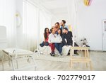 group of creative young friends ... | Shutterstock . vector #702779017