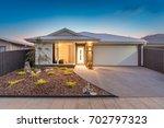 house facade during twilight. | Shutterstock . vector #702797323